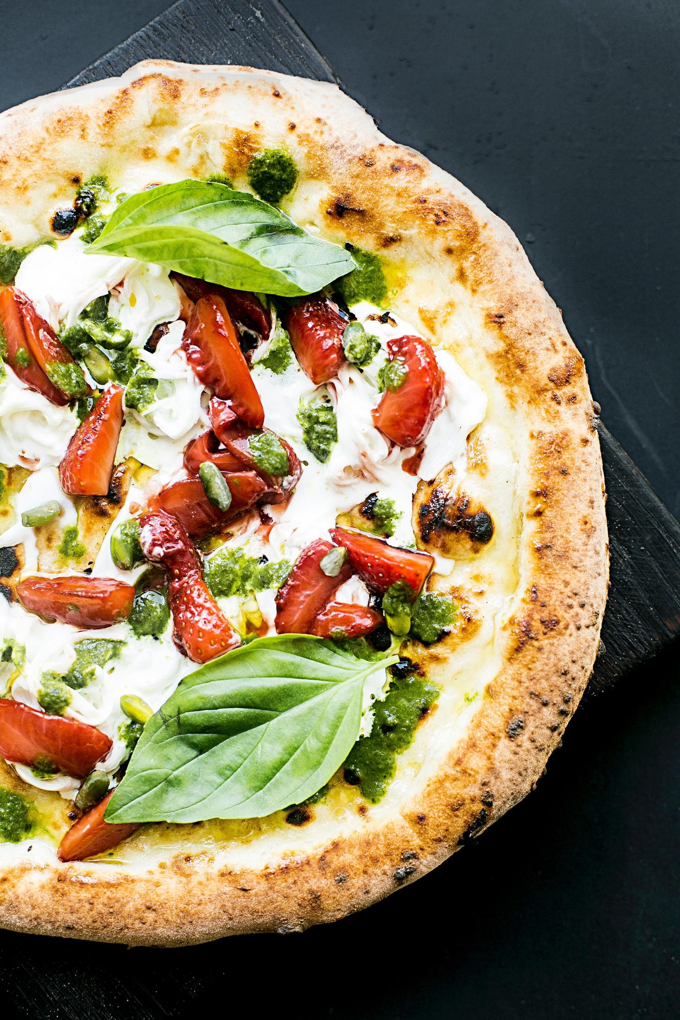 pepperoni-pizza-and-basil-leaves
